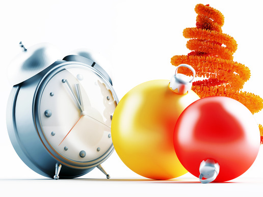 Yellow and red metallic christmas decorations and alarm clock
